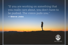 person standing in desert silhouetted by dusk, sun in the horizon of desert with person in foreground, yellow orange sunset, person in the desert, JWU Online logo, Steve Jobs quote