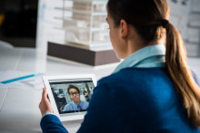 woman uses FaceTime with a colleague, person using video conferencing, Apple FaceTime bug prompts security concerns
