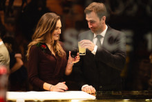 nicely dressed man and woman sharing a drink, black tie gala, black tie event