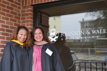 Two master's graduates before commencement