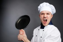Angry chef holding a pan