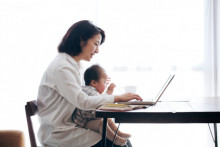 mother with infant, mother surfing laptop with infant, mother on her computer with baby in lap, mother studying online degree