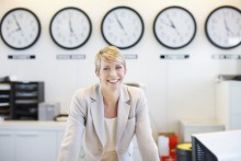 woman with multiple time zone clocks