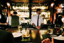 bartender serving drinks at busy restaurant, alcohol, bottles of alcohol, restaurant, restaurant bar