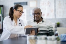 public health professional talking with senior citizen, doctor talking with patient