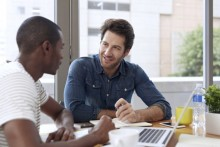 Men discussing at a desk
