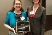 JWU Online Student Karen Duey accepting the UPCEA 2017 Outstanding Student Award