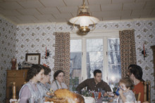 Family gathered around table for dinner