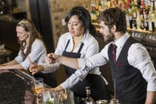 manager and bartender working befhind a bar