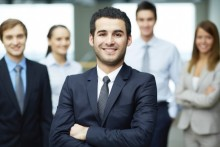 human resource employee, young business man, employee smiling at camera with arms crossed