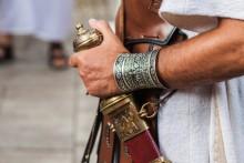 julius ceasar holding a sword
