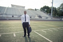 man with a briefcase on a football field