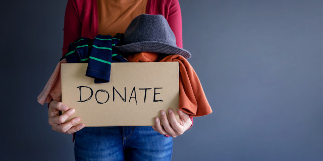 person holding box of things to donate