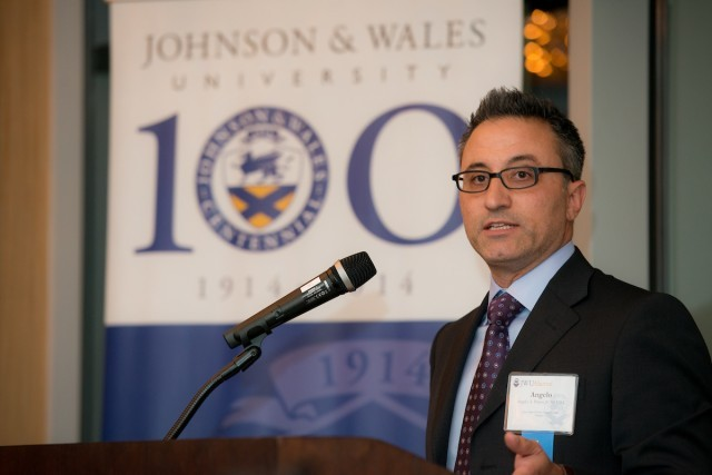 Angelo Pitassi, Johnson & Wales University, man speaking, man with glasses and suit speaking at podium