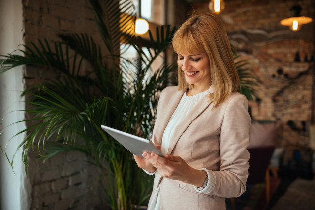 hospitality professional, hospitality manager, hospitality professional on tablet device, hospitality professional at work