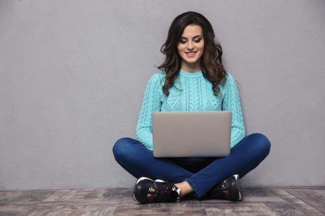 girl sitting on a laptop