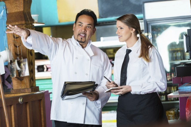 Kitchen manager speaking with an employee