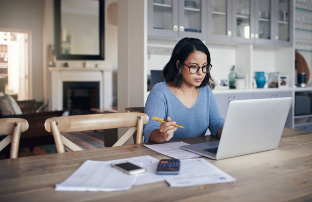 young woman on laptop studying for degree