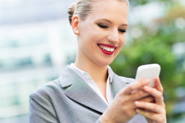 woman smiling on her phone