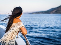 woman on boat looking out at sea, boat out on the sea, boat on the water