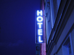 hotel neon sign, hotel building, hotel sign, are robots the future of hotels blog article