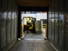 worker operating forklift, warehouse, distribution, supply chain, shipping