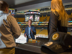 johnson and wales university professor Patrick Leary, sport leadership professor, professor with students, JWU professor with JWU students, professor and students in suite at TD Garden