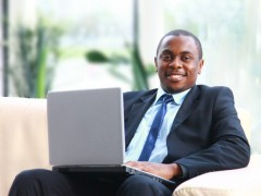 Man sitting working on a laptop