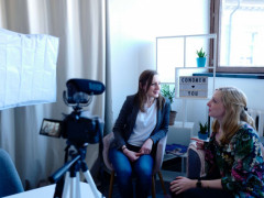 women on camera interview