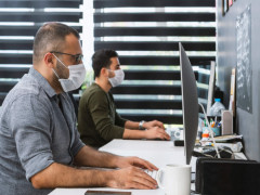 employees in office with masks on