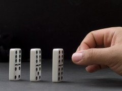 hand with a row of dominoes