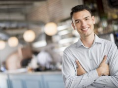 man standing in a cafe
