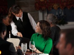 a server helping a customer at a restarant