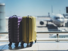 two suitcases sitting in an airport