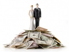 a couple standing on top of money
