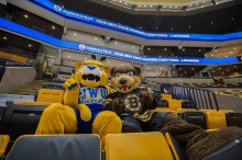 johnson and wales university partnership with boston bruins, blades the bruin with willie t wildcat, boston bruins mascot with jwu mascot, jwu mascot, boston bruins mascot, jwu and boston bruins mascot at TD Garden, jwu mascot and boston bruins mascot sitting in TD Garden