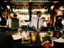 bartender serving drinks at busy restaurant, alcohol, bottles of alcohol, restaurant, restaurant bar