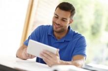 Man looking at a tablet