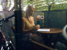 college female writing notes on a deck, unexpected benefits of meditation