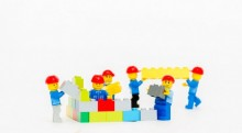 lego people building a structure