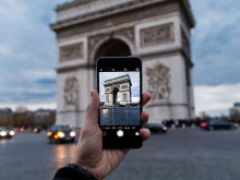 person taking photo of Arc de Triomphe