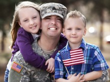 Service member with his children